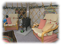 stove and chairs in this yurt in betws-y-coed