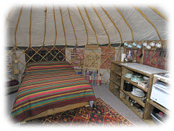 bed and kitchen area in yurt